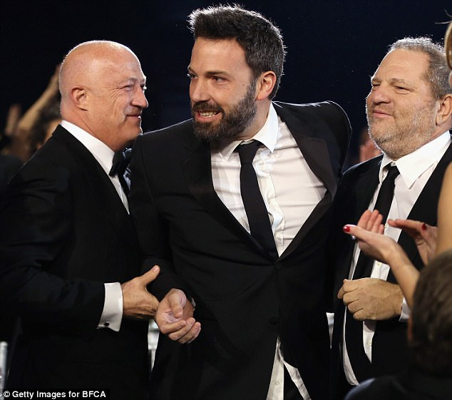 C.A.A. founder and managing partner Bryan Lourd (left) is pictured with Weinstein and Ben Affleck at the 2013 Critics' Choice Awards. Affleck, who has since denounced Weinstein, was accused of covering up his abuse when the scandal first broke