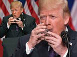 Donald Trump has sparked dementia concerns after he was spotted drinking water with two hands like a small child