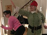 Sue Perkins (left) was pictured twerking next to television star Emma Kennedy (right) during a festive party