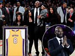 Kobe Bryant was honored by the Los Angeles Lakers as they retired both his No 8 and No 24 jerseys on Monday night (pictured, at halftime)