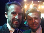 Simon Wilson (right) appeared on camera  next to presenter Clare Balding (left) in a VIP seat
