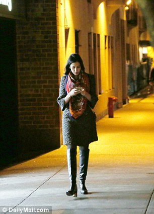 The top Clinton aide is seen walking home after dinner