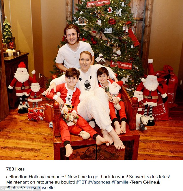 'Holiday memories': Celine Dion has shared a photograph on Thursday of her and her boys, Rene-Charles, 15, and twins Eddy and Nelson (who sported new short 'dos), marking Christmas this year, their first without the singer's husband Rene Angelil