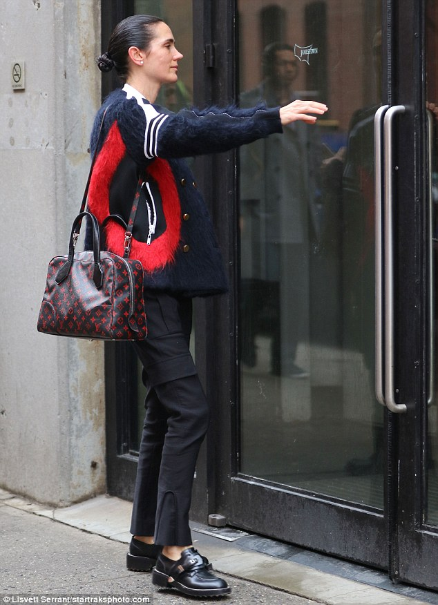 Striking:With white striped detailing on either shoulder and distinctive red patches marking its generously cut pockets the jacket ensured Jennifer stood out during an otherwise low-key appearance