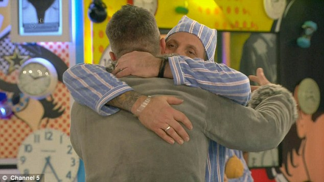 Hugging it out: The pair put on a very friendly display as Brandon waved goodbye