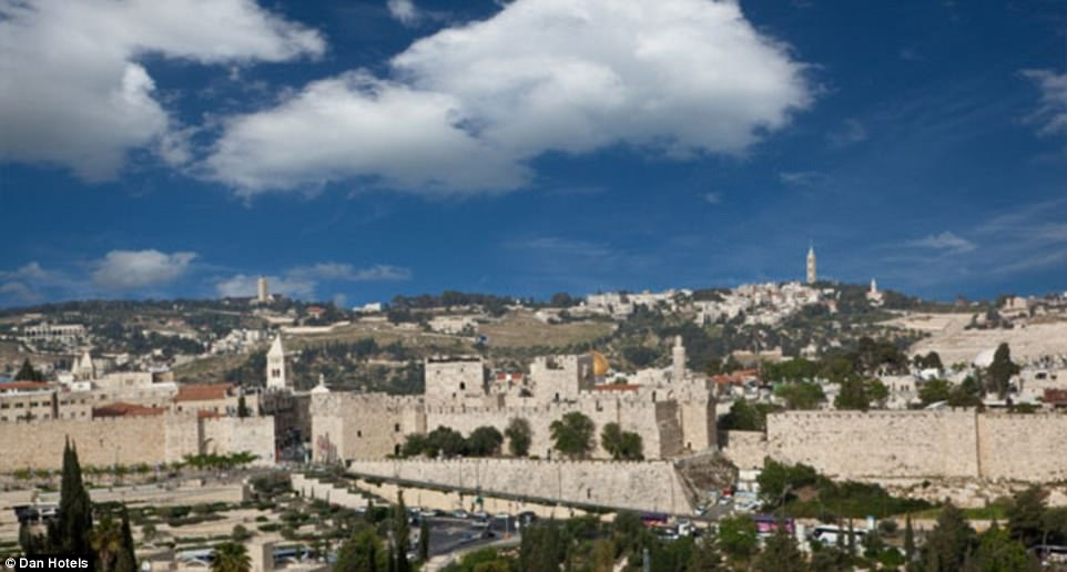 The view of Jerusalem as seen from the King David Hotel includes the walls of the Old City with the Dome of the Rock slightly peering out