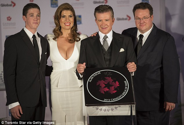 Fighting: 'Robin and Brennan are taking legal action in order to honor the memory of their father, protect his legacy' their lawyer told THR. Alan and Tanya are pictured with Brennan (right) and Carter (left) in 2013