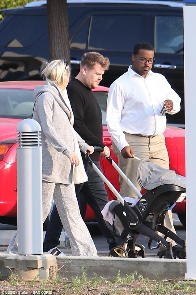 Maternal glow: Julia, 38, looked glowing for the family outing, donning a dappled grey tracksuit
