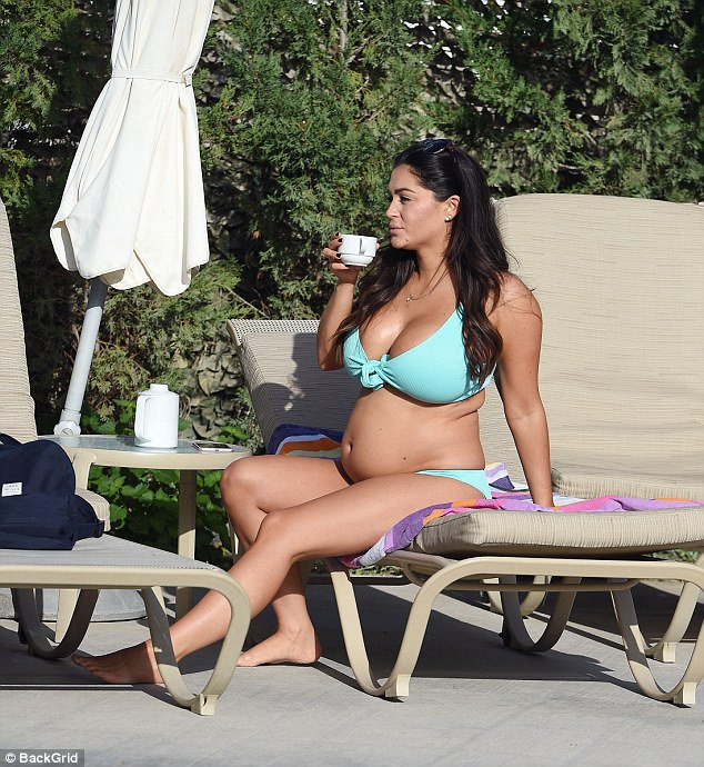 Tea break! Casey was also spotted enjoying a cup of tea as she relaxed poolside, after revealing all about her unexpected pregnancy