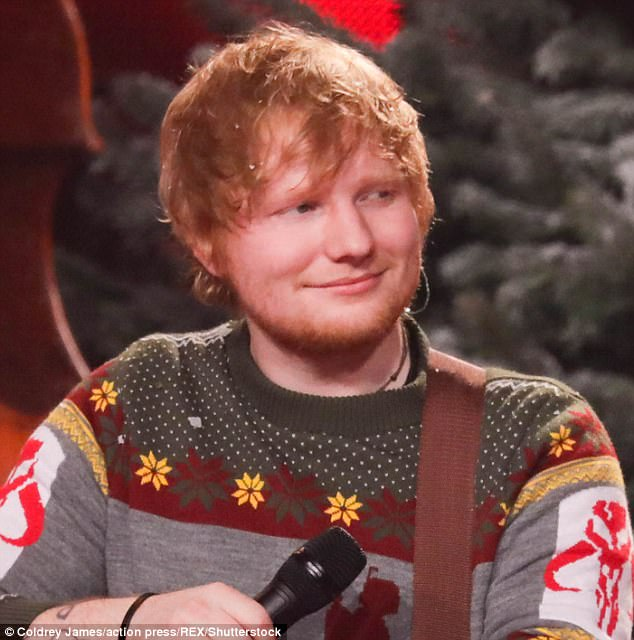 'I've got the song ready': Ed Sheeran confessed he wrote the lyrics for the James Bond theme song three years ago to ensure he is prepared if he is ever called upon to write it when he appeared on The Late Late Show on Friday (pictured at The Voice Final in Germany, December 2017)