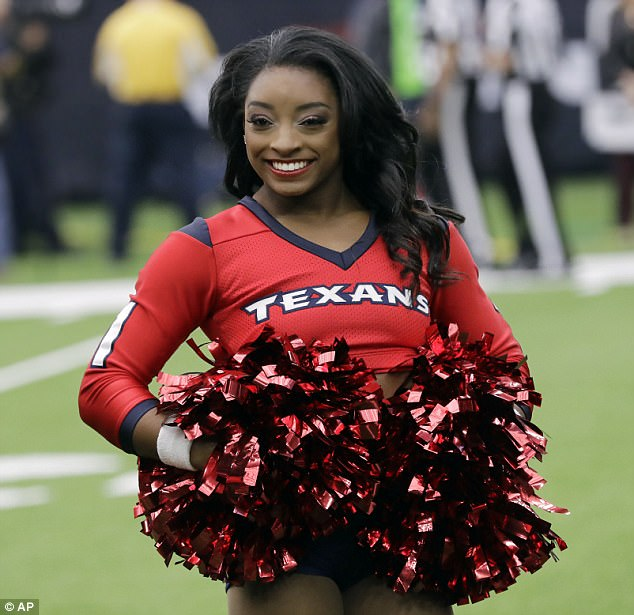 Hitting the field: Gymnast Simone Biles made her debut as an honorary Houston Texans Cheerleader on Sunday