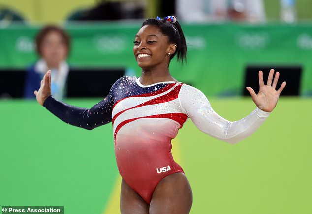 Hands up: Simone is a four-time Olympic champion - but has expressed a wish to be a cheerleader