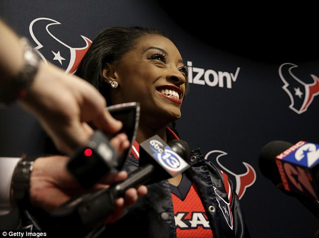 All smiles: Simone is seen talking to the media before hitting the field on Sunday