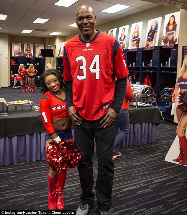 Little and large: While at the game, 4'9 Simone posed with 7'0 basketball legend Hakeem Olajuwon