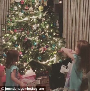 A little help: Jenna Bush Hager's daughters Poppy (L), two, and Mila (R), four, use a wand to 'magically' light up their Christmas tree in a sweet Instagram video