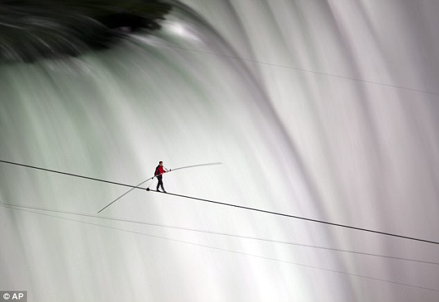 In his blood: Wallenda can be seen walking over Niagara Falls on a tightrope during his incredible 2012 stunt