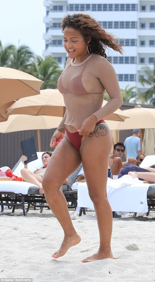Having a blast... The stunning star was seen walking along the sand, smiling and laughing as she enjoyed her vacation