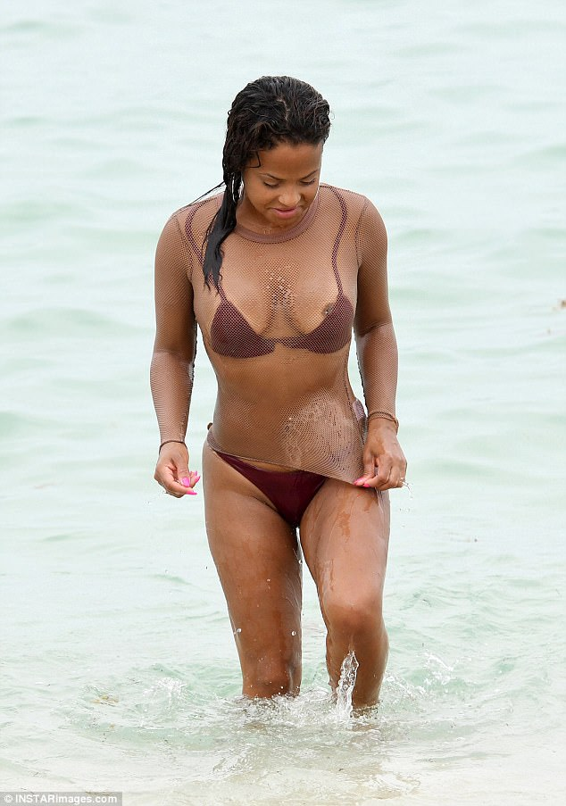 Oops!Christina Milian suffered a wardrobe malfunction as she hit the beach in Miami on Saturday