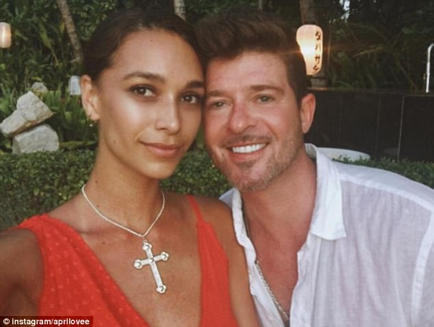 'He looks ten times better than me': Proving that wasn't a one woman show, April also included her beau Robin in on her titillating display
