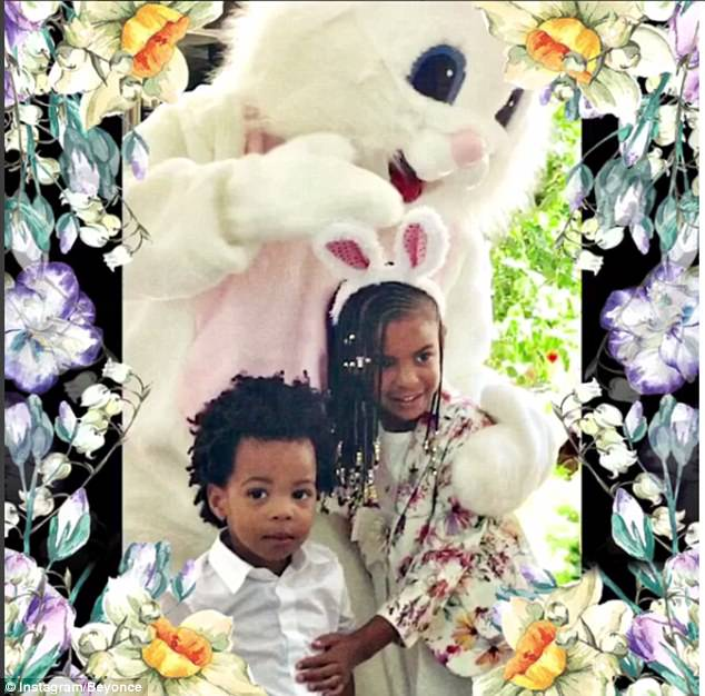 Easter fun: The little girl looked adorable in a matching white dress and pink shoes, making for a coordinated mother-daughter look as she posed with Kelly Roland's son Titan