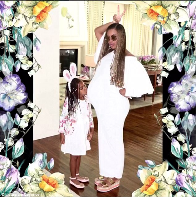 Cute kiss on the bump: Blue Ivy looked excited at the thought of becoming an older sister to twin babies