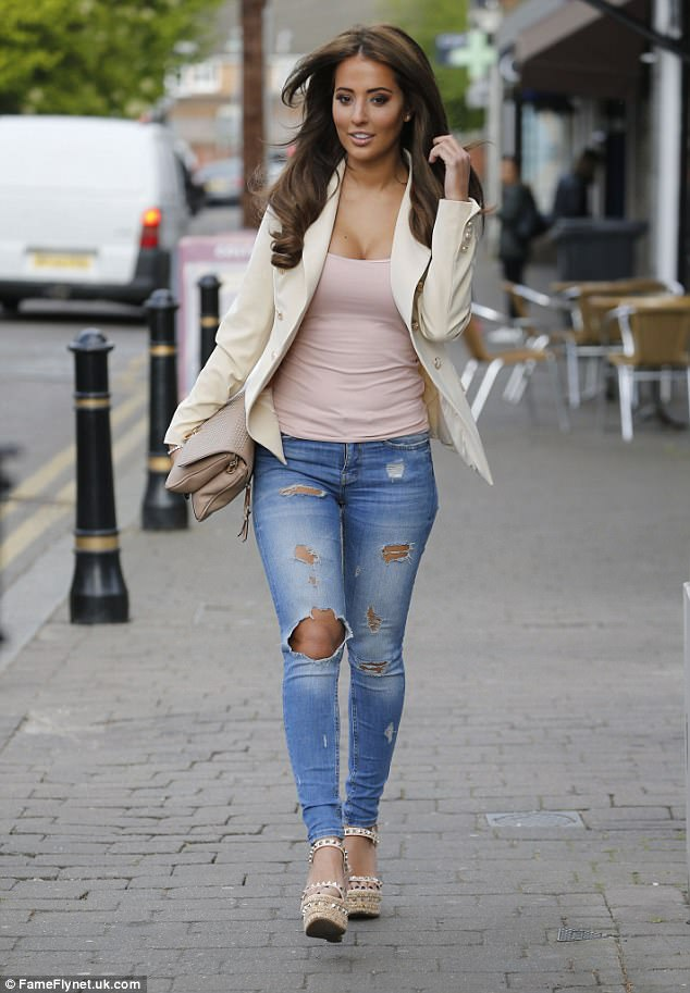 Great jeans: She was joined at filming by her glamorous pal Yazmin Oukhellou, who also opted for ripped jeans paired with a skin-tight vest and blazer