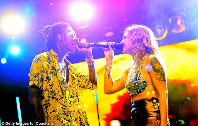 Toe-tapping: She delivered a rousing performance alongside Wiz, sharing a friendly hug following their joint set
