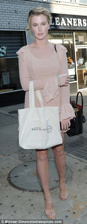 """Sky high: She added a few more inches to her 6'2"""" frame with a pair of matching nude ankle strap heels"""