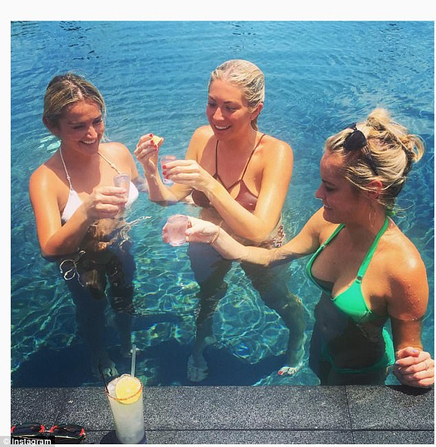 Cheers: 'This is a couples' resort; therefore, everyone is confused by us,' Stassi said as she stood in the pool with the two pals
