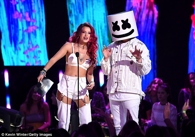 Better luck next time: Unfortunately, Thorne - who presented with Marshmello (R) - lost all three fan-voted trophies to Zendaya, Lucy Hale, and Ariana Grande