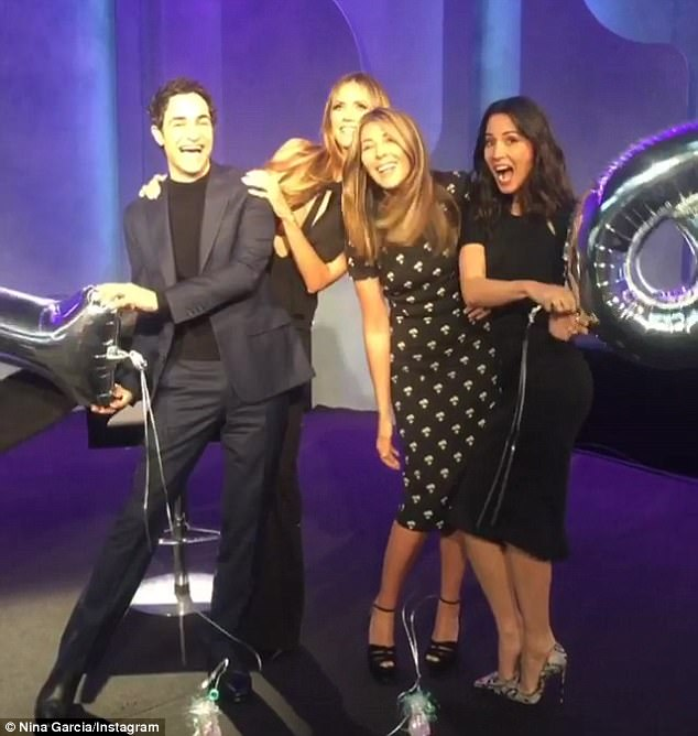 'So much fun!' Olivia Munn (R) guest judges Thursday night's premiere of the 16th season of Lifetime's Project Runway alongside judges Zac Posen and Nina Garcia (2-R)