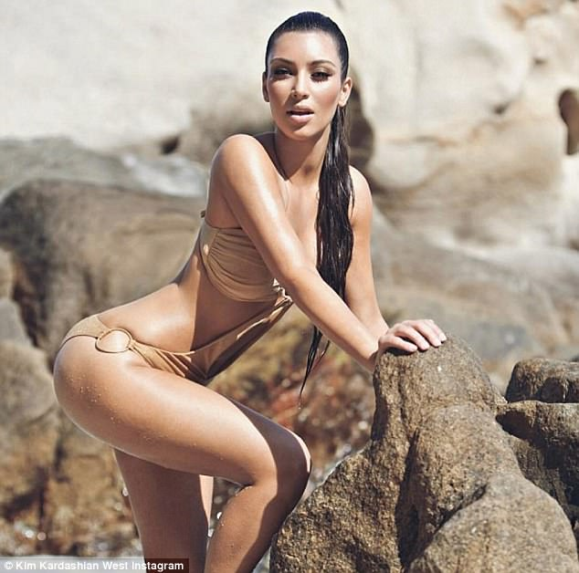 Looking good: Kim Kardashian shared this throwback image on Wednesday where she was posing in a monokini in Mexico