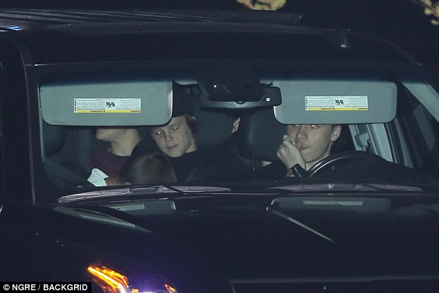 Designated driver: Brooklyn took to the wheel as he prepared to drive them home