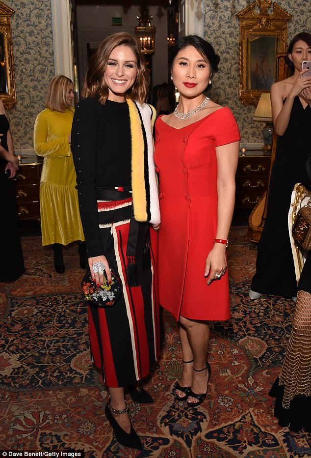 Two's company:Layering up, the former reality star draped a yellow stole over herself, whilst she boosted her frame with a pair of black heels (pictured withIris Alexander)