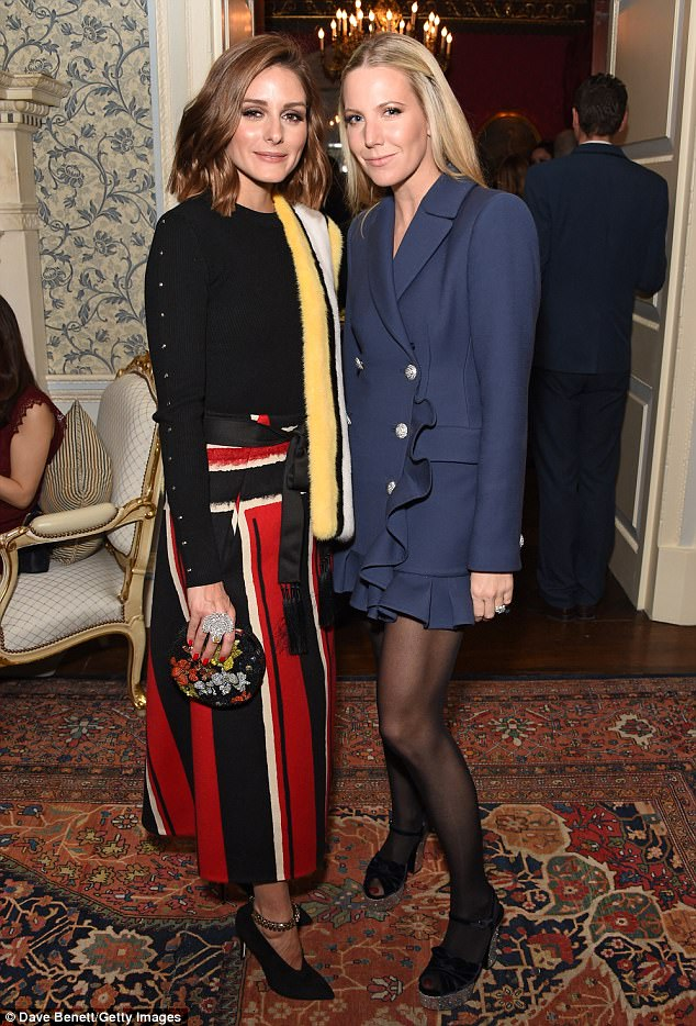 Double trouble:Appropriately attired for a jewellery bash, Olivia donned an oversized diamond ring as she posed withAlice Naylor-Leyland at the party