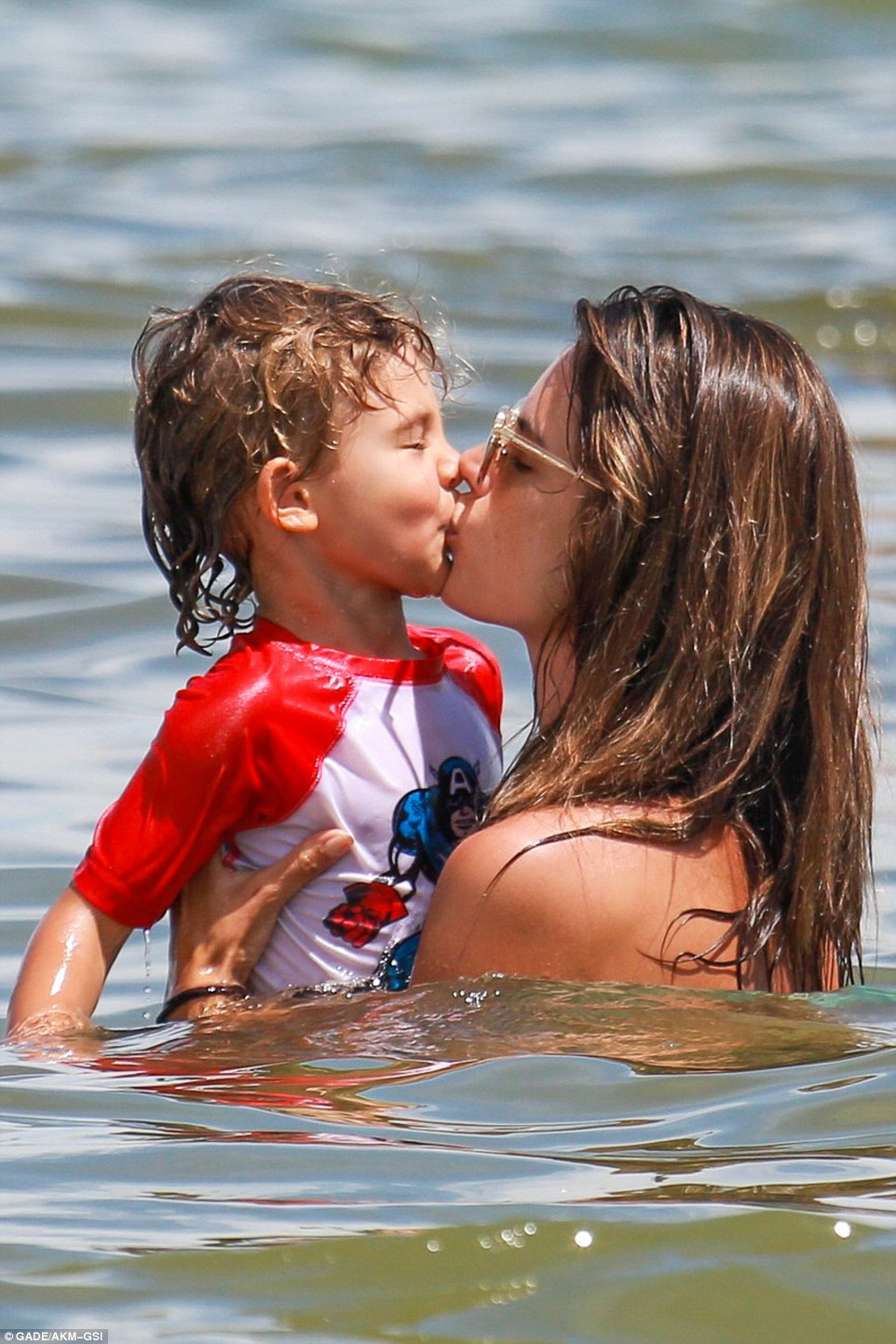 Nice job: The lucky youngster got a kiss from his mama for his efforts