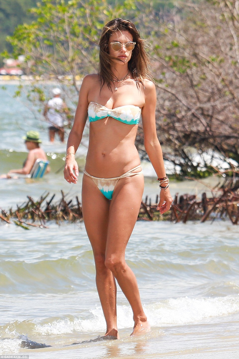 Blingy:And she wore plenty of jewelry as she took her ocean dip. The star had on several beaded and leather bracelets as well as a necklace that had a star pendant