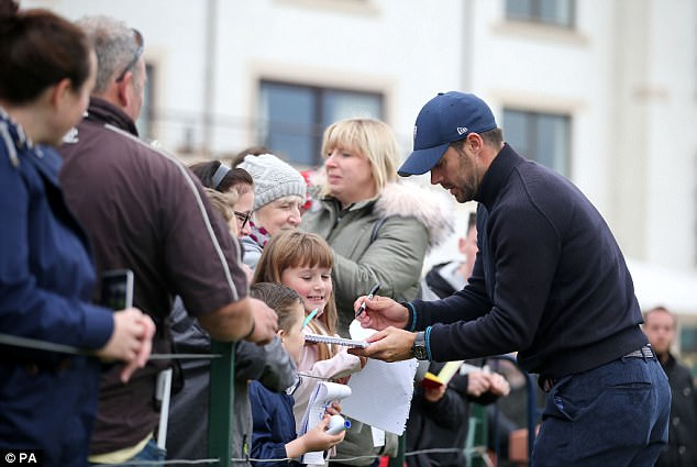 Fan love! He obligingly signed a group of young fans' autographs after the event