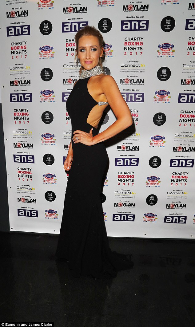 Sensational: Catherine Tyldesley ensured all eyes would be on her as she slipped into a backless black gown for a charity boxing match at The Hilton Hotel in Manchester on Saturday