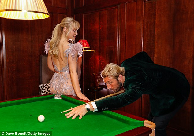 Attention-grabbing:As the pair enjoyed a quick game of pool, it was a wonder England rugby star Chris could concentrate on his shot as Camilla rested her bootylicious behind on the table