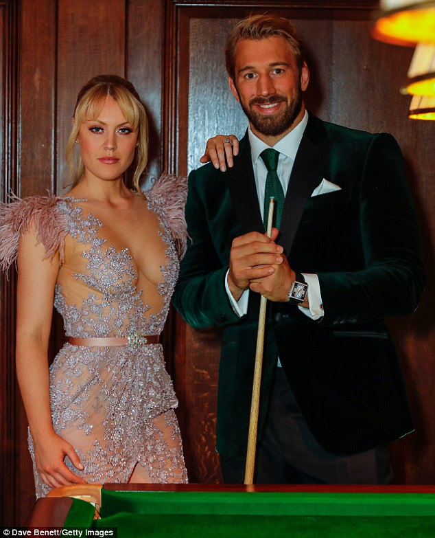 Sizzling: Camilla struck a serious pose as Chris held onto his cue