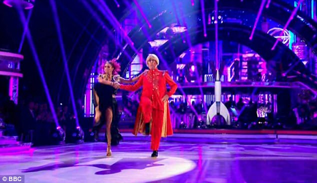 Red hot!A dramatically dressed Reverend Richard Coles and Dianne Buswell were up next, dancing the Paso Doble to Flash¿s Theme from Flash Gordon
