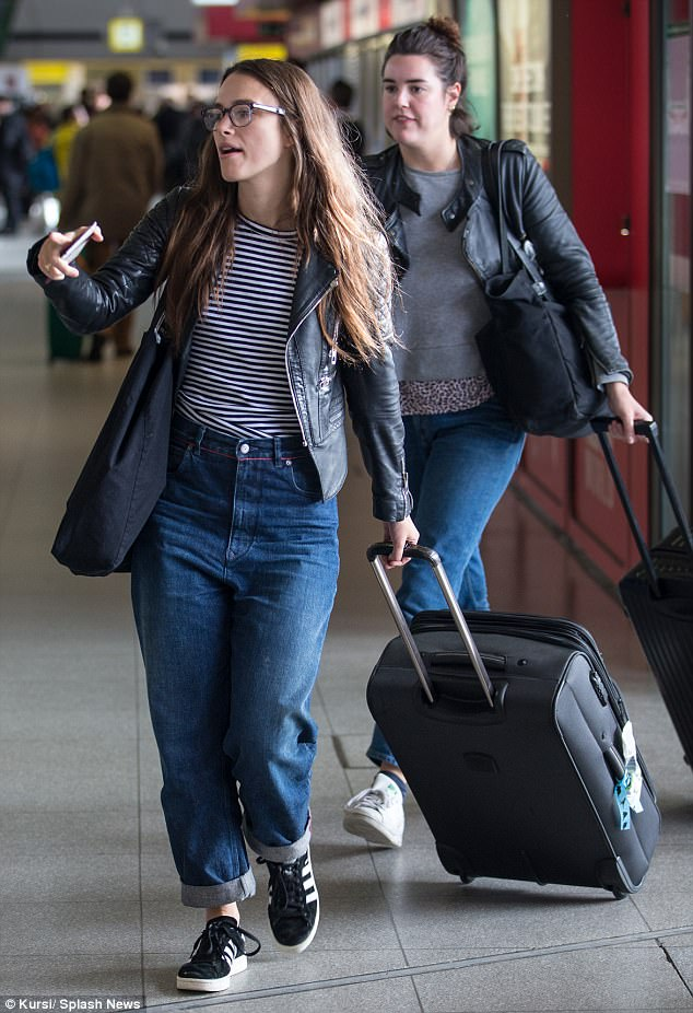 Casual:Keira Knightley looked content and happy as she strolled through Berlin Tegel Airport on Saturday