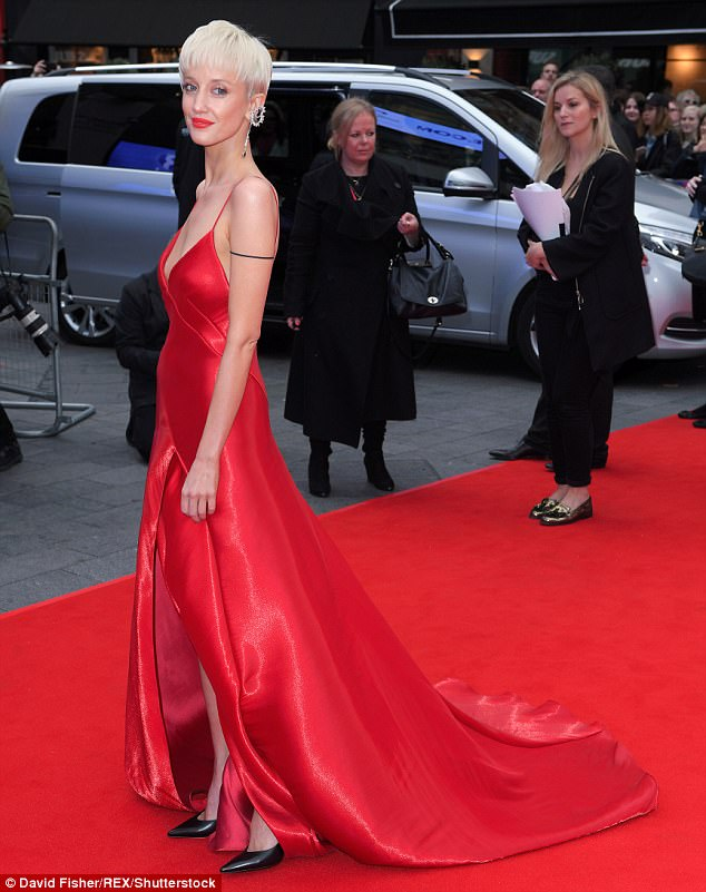 Red hot: Andrea Riseborough, who plays Marilyn Barnett, Billie's hairdresser and lover in the film, flashed her pert assets in a plunging scarlet silk gown