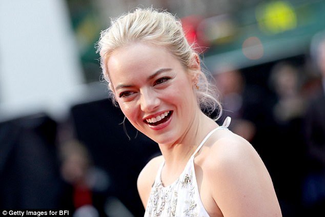 Gorgeous: Emma flashed her pearly whites as she smiled for the cameras