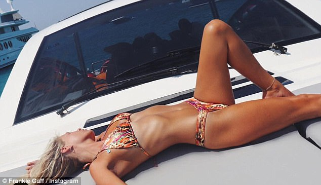 Bikini babe:She previously showcased her svelte frame in a sizzling Instagram snap while strewn across a luxurious yacht while clad in her colourful bikini