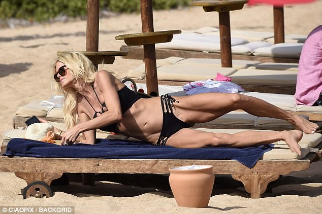 Slender: The model was certainly not afraid to flaunt her figure as she first hit the beach in a skimpy black bikini