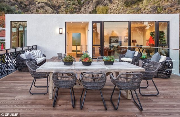 Al fresco dining: The living area opens up to a large patio perfect for entertaining guests