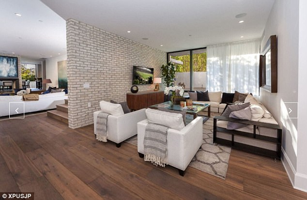 Kendall's old space: The luxurious living space comes complete with hard wood floors, exposed brick walls, and a rooftop patio perfect for dinner parties under the stars.