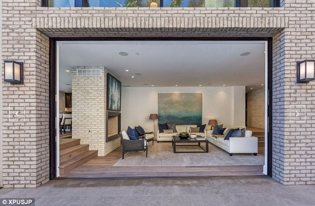 Open plan: Large windows and doors throughout the house make for a light and airy feel